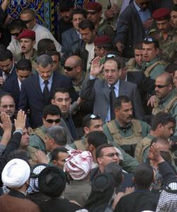 Prime Minister Nouri al-Maliki waved to pilgrims yesterday during his visit to the shrine of Imam Hussein. Maliki also spoke of the need to move forward on political unification.