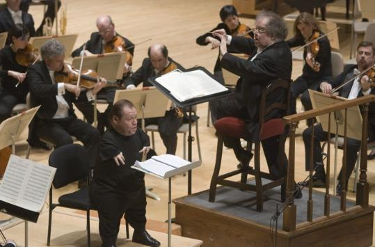 James Levine leads the BSO with bass-baritone Thomas Quasthoff (front left) last night.