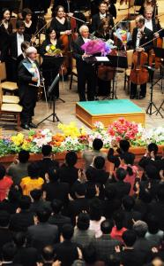 Music director Lorin Maazel (center) and the New York Philharmonic received a standing ovation from the audience after the performance.