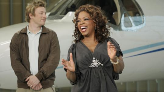 Oprah Winfrey (with Jamie Oliver of 'Naked Chef') pits Big Givers against each other.