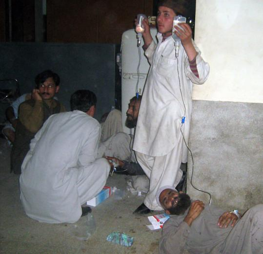 Suicide attack victims lay on a hospital floor in Mingora, Pakistan. A funeral was being held at the time of the bombing.