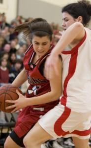 Melrose's Siena Mamayek manages to avoid traffic as she drives to the basket against Reading.