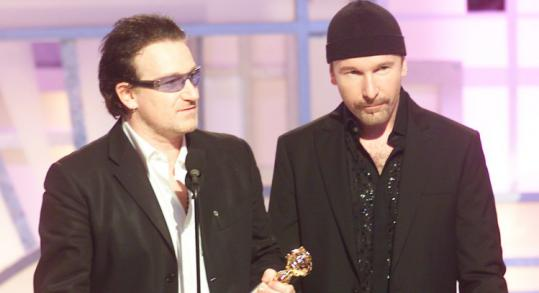 U2 singer Bono (left) and guitarist The Edge at the Golden Globe Awards show in 2003, where Bono uttered a vulgarity.