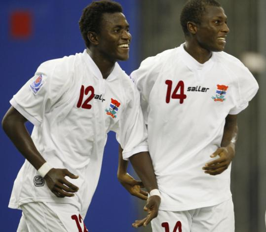 Abdoulie Mansally (left) and Sainey Nyassi celebrate Mansally's free-kick goal at the Under-20 World Cup.