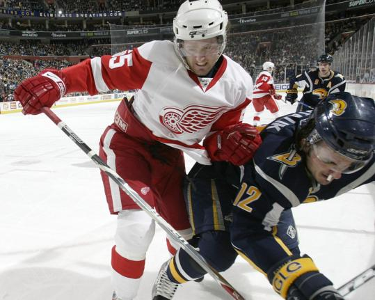 In a battle of slumping teams, defenseman Niklas Kronwall and the Red Wings were able to shove aside Ales Kotalik and the Sabres.