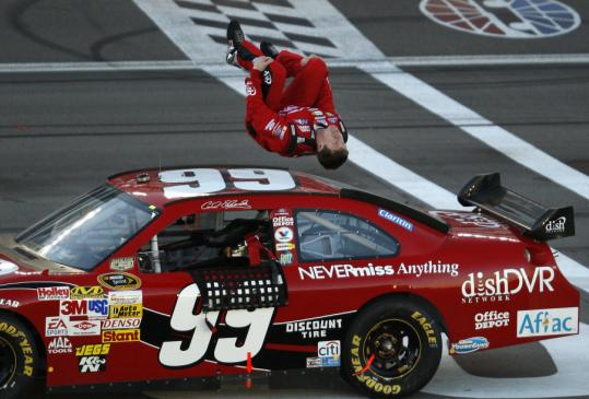 Carl Edwards does his traditional backflip after holding off Dale Earnhardt Jr. at Las Vegas Motor Speedway for his second victory in a week.