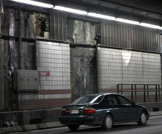 Tiles have been removed on the northbound section of the Thomas P. O'Neill Jr. Tunnel in Boston as part of ongoing leak repairs. The Big Dig still has about 2,000 maintenance items to take care of, so workers will be making repairs for at least the next 18 months.