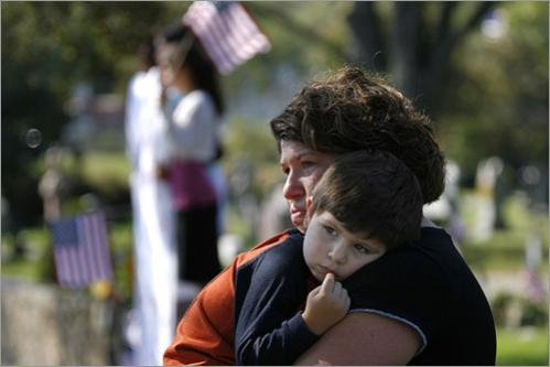 Buy photographs by Joanne Rathe Deana Filipiak of Swawpscott cries as she holds her son Nathan, 2, as the coffin carrying Jared Raymond passes. Thousands watched the funereal procession. Raymond was killed on duty in Iraq.