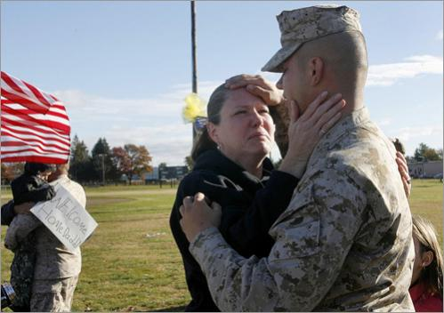 Buy photographs by Joanne Rathe Gina Bonti hugs her son Lance Corporal Zach Laegel during the homecoming for the 1st battalion 25th Marines.