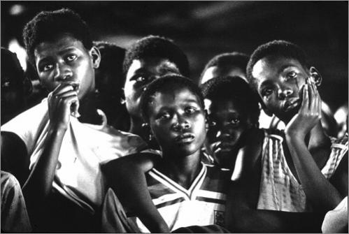 Buy this picture! Friends mourn during the funeral service for a youth that was killed in a revenge attack in Leandra Township, South Africa in 1985.