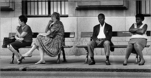 Buy this picture! Whites and blacks wait for a bus in downtown Johannesburg in 1990. The city's buses only became integrated a month earlier.