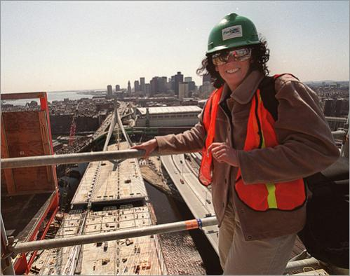 Buy photographs by Joanne Rathe Joanne Rathe, pictured here on the Zakim bridge during contruction in 2001, has been working at the Boston Globe since 1985, where she is an Assistant Chief Photographer. She has covered a wide variety of assignments over the years from the Northwest Frontier of Pakistan documenting Afghan refugees to the Northwest Territories of Canada photographing the winter ice road. She has covered strife in Nicaragua, the Olympics, political campaigns and the community of Globe Northwest. She has received multiple prizes from the National Press Photographers Association, including two first prizes, The World Press Children's Award for post-apartheid South Africa, The World Hunger Award for Rural Poverty in New England and many Boston Press Photographers Awards. Prior to the Boston Globe, Joanne worked at the Boston Herald and The Springfield (MA) newspapers. She is a graduate of Boston University, College of Communication and is from Westbury, New York.