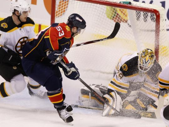 Letting the chips fall where they may, Bruins goalie Alex Auld had the puck covered on Panthers center Brett McLean's second-period shot.