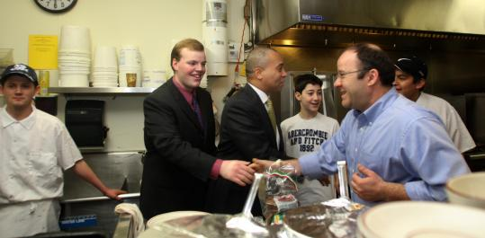 Sean Garaballey (second from left), campaigning last month with with Governor Deval Patrick, shook hands with Arlington Diner owner Themis Boretos. Peter Boretos, the owner's son, is to the governor's right.