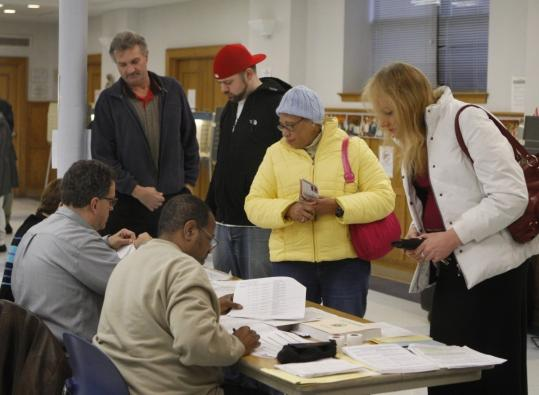 About 3.3 million Ohioans, including these in Cincinnati, cast ballots in Tuesday's primary, despite rain that later turned to sleet and ice. Some polls ran short on paper ballots.