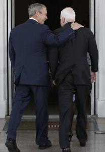 President Bush welcomed Senator John McCain of Arizona, a onetime rival who is now vying to succeed him, as they entered the White House yesterday.