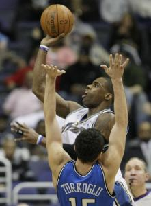 Antawn Jamison barrels over Hedo Turkoglu for 2 of his 19 points.