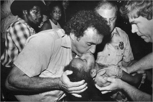 A Chelsea policeman gives mouth-to-mouth to a young girl overcome by smoke during an early morning fire in Chelsea in 1982. He was assisted by other Chelsea officers before the fire department arrived, but their attempts were in vain as three children died in the fire.