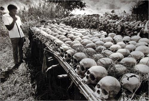 War refugee Lawrence Makubaga, 22, views a table where seven of his relatives are among the piles of bones and skulls dug up by local farmers in the fertile fields of the Luwero Triangle region north of the Ugandan capital of Kampala in 1987. Thousands of Ugandans were killed by dictators Milton Obote and Idi Amin during their reign of terror. Now, with refugees returning, the bones of the victims are being found and displayed as a memorial and reminder to the past.