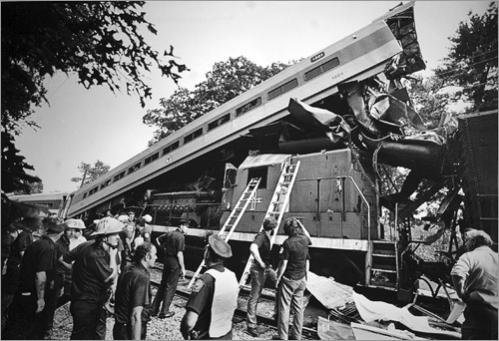 Rescue workers stand by a commuter train wreck near Prides Crossing in Beverly in 1981, where a four-car B&M commuter train slammed into the engine of a freight train killing three people and injuring 28. The engineer of the commuter train was killed.