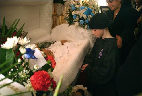 Patrick Shine, 13, from Mission Hill, saw Luis Gerena on the day Gerena died. Now he visits Gerena's body at the wake at the John P. Hearn Funeral Home. Gerena was shot to death at the Jackson Square MBTA Station on Jan. 12, 2007.