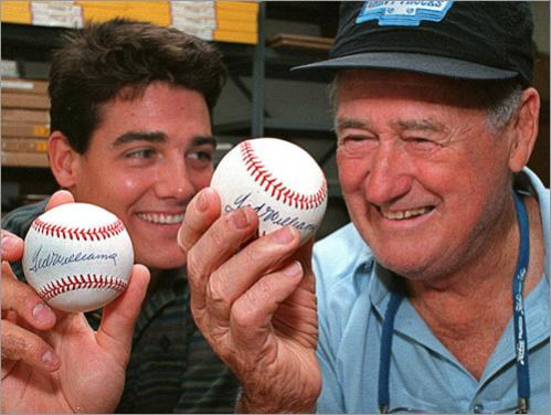 John Henry Williams and his father Ted in the Ted Williams business office in Citrus Hills, FL in 1995.