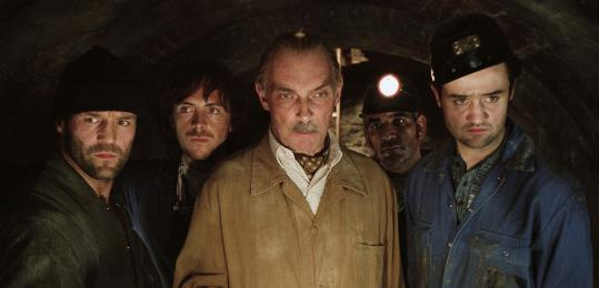 Jason Statham (left), Stephen Campbell Moore, James Faulkner, Alki David, and Daniel Mays.