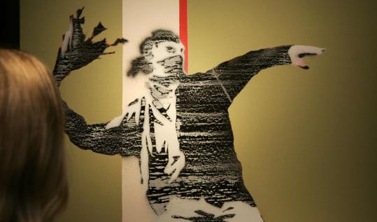 The spray paint stencil titled 'Riot Green' is among the works of British artist Banksy on exhibit in London's Andipa Gallery.