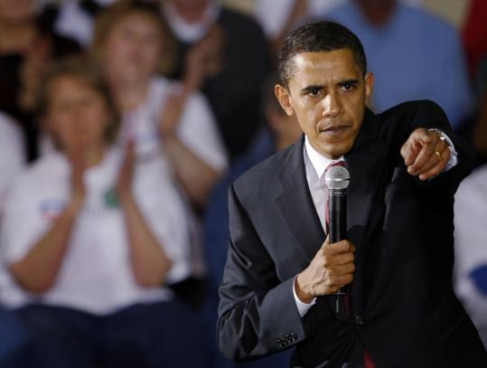 Barack Obama responded to a question at a party caucus in Casper, Wyo., yesterday. Rival Hillary Clinton has questioned whether Obama has been consistent in his position on withdrawing troops from Iraq.