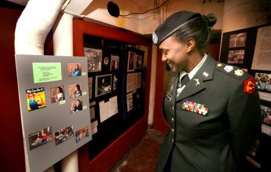 Major Margaret Oglesby of the Army National Guard viewed items in the exhibit on the history of women in the American military on display aboard the USS Massachusetts in Fall River.