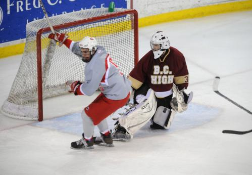 Catholic Memorial forward Mike Collins, left, celebrates his winning overtime goal against BC High goalie Sam Marotta.