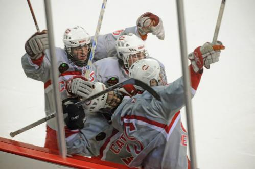 Catholic Memorial players mob forward Mike Collins, right, and celebrate after Collins scored the winning goal in overtime to beat BC High, 3-2.