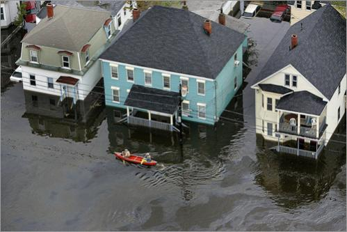 Flooding in Lawrence, MA leaves residents paddling through floating slicks of oil in 2006.