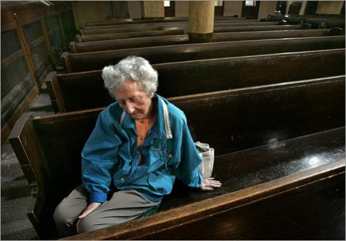 Esther Doherty, 78, sits in the pew she's been using at St. Therese Church in Everett since she was married there 52 years ago. The church was on the list of those threatened with closure in 2005. She has been coming to the church on a vigil to try to keep it open.