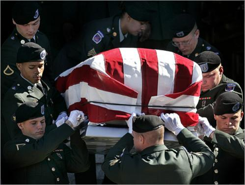 Members of the Fort Drum, NY Third Brigade Special Troops Battalion carry the coffin of Sgt. Pierre Raymond out of Saint Patrick's Church in Lawrence, MA. Raymond was killed serving in Iraq in 2005.