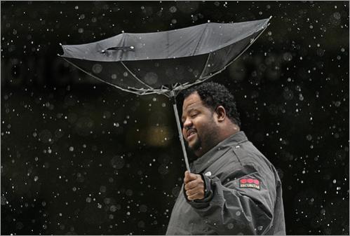 Strong winds billow Lavanixon Louis' umbrella in 2006 as he walks on Staniford Street in Boston.