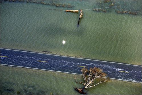 A Cameron, LA road lies submerged in the 2005 aftermath of Hurricane Rita.