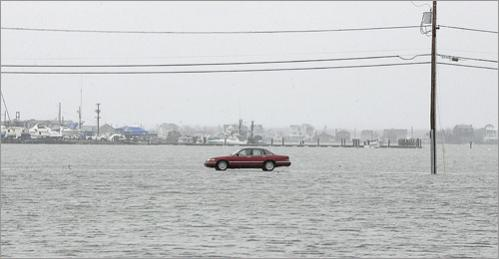 At high tide in the spring of 2007, the saltmarsh around Island Path in Hampton, NH was flooded enough to make it look as though this car was driving on water.