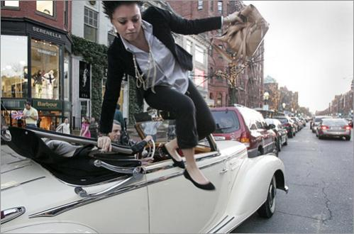 Summer Martin of Atlanta jumps from a 1952 Cabriolet A Mercedes on Newbury Street as Mehrdad Mehr of Iran finishes parking the convertible on an execeptopnally warm January evening in 2007.