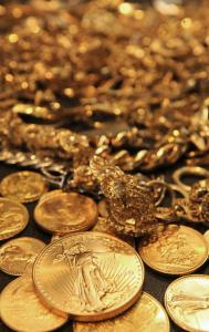 Gold has risen to nearly $1,000 an ounce, and people are cashing in their jewelry and stashes of coins to raise money quickly.