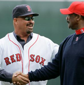 Mike Greenwell shakes hands with another ex-Red Sox left fielder, Jim Rice (right), after Greenwell threw out the ceremonial first pitch before yesterday's game against the Mets.
