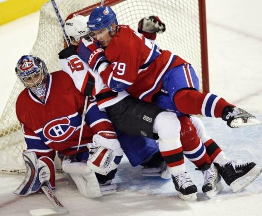 Not even a visit from the Devils' Jamie Langenbrunner, checked into the net by Andrei Markov, could faze Montreal goalie Carey Price.