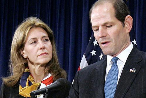 New York Governor Eliot Spitzer's wife, Silda, stood beside him at a press conference Wednesday as he announced his resignation amid a prostitution scandal. She's one in a long line of spouses who have stood by their partners through thick and thin — at least for the cameras.