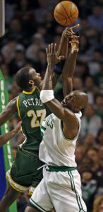 Kevin Garnett and Johan Petro fight for a first-half rebound. Petro finished with 10 boards, Garnett had six.