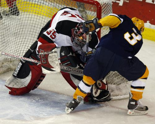 Reading goalie Jeff Wyer (29) guards the post as Xaverian forward Ken Aufiero (3) looks for the loose puck.