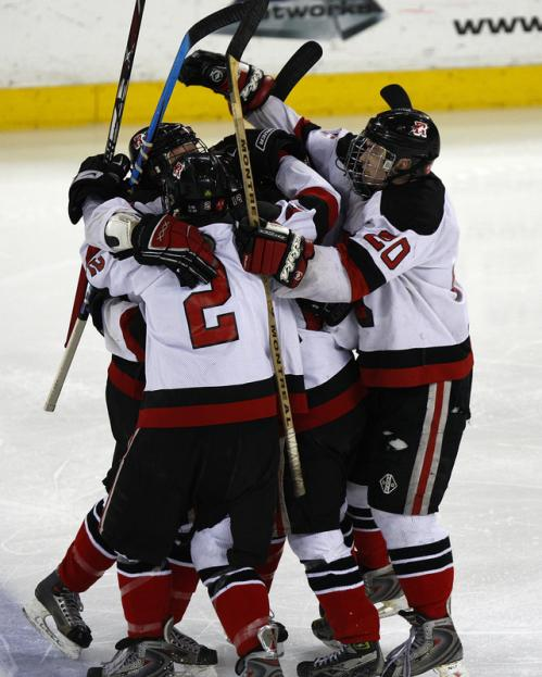 Reading players gather to celebrate Garrett Collins's second-period goal.