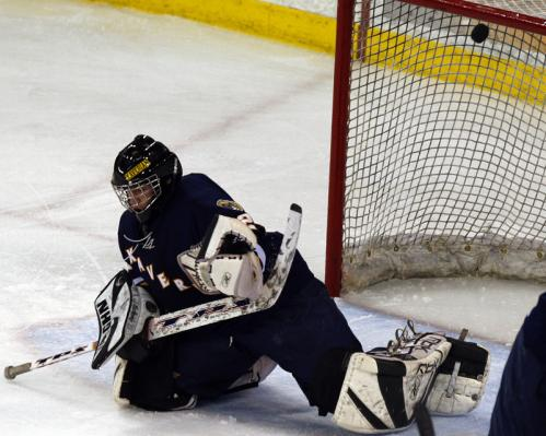 Xaverian goalie Kyle MacDonald goes down but the shot from Reading's Quinlan Junta is already in the net.