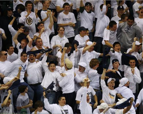 Malden Catholic fans celebrate the game-tying goal against Catholic Memorial.