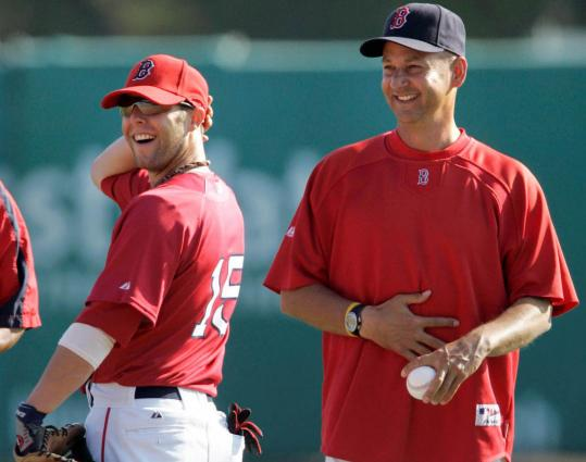 Second baseman Dustin Pedroia and manager Terry Francona enjoy a laugh yesterday.