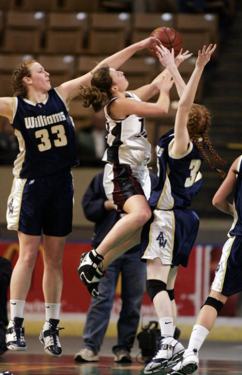 Archbishop Williams' Valerie Driscoll (33) and Meghan Black keep the pressure on Quaboag's Macey Gaumond.